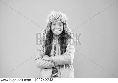 Faux Fur Trend. Playful Kid Girl Wear Fur Hat With Ear Flaps Pink Background. Soft Furry Accessory.
