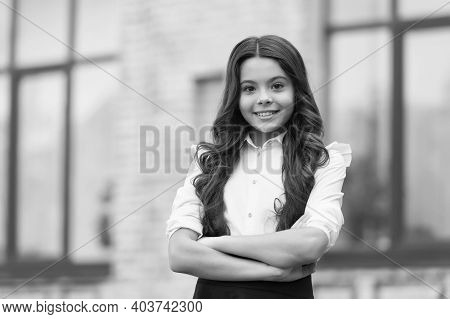 Tradition Of Confidence. Confident Kid Keep Arms Crossed. Confident Look Of School Girl. Fashion Uni