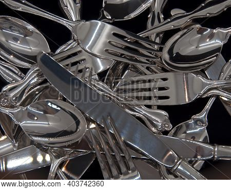 A Photograph Of Sterling Silver Flatware For Eight In A Jumble