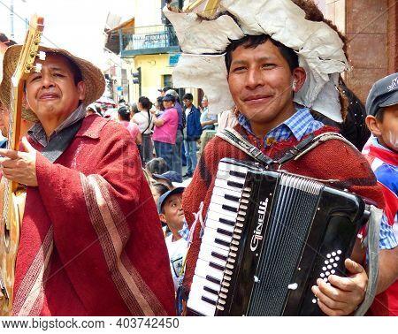 Cuenca, Ecuador - February 22, 2020: Carnival Parade In Cuenca City. Indigenous Village Musicians Me