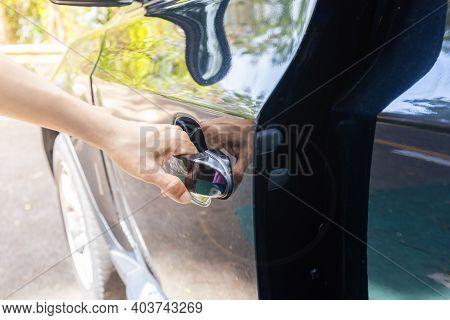 Hand On Handle Close Up Of Women Hand Opening Car Door