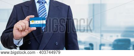 Cropped Image Of Businessman Holding Plastic Credit Card With Printed Flag Of Honduras. Background B