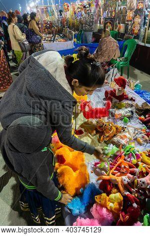 Kolkata, West Bengal, India - 31st December 2018 : Woman And Kid Buying Handicraft Products At Hasta