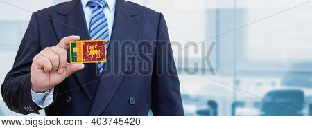 Cropped Image Of Businessman Holding Plastic Credit Card With Printed Flag Of Sri Lanka. Background