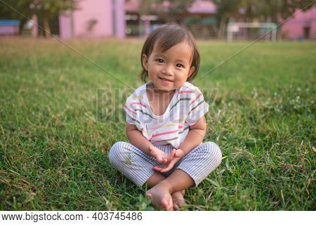 Cute Little Asian 1 - 2 Years Old Toddler Baby Girl Child Smiling At Camera, Barefoot Practices Yoga