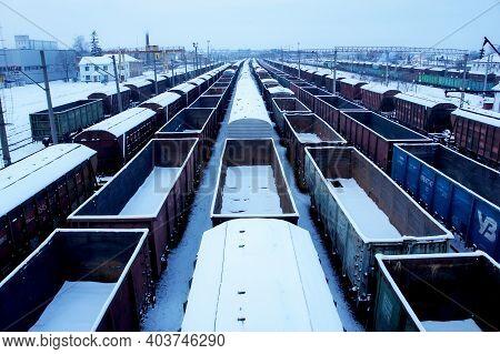 Rivne, Ukraine - January 17, 2021. Railway Station. Railway Freight Trains And Wagons. Rail Cargos.