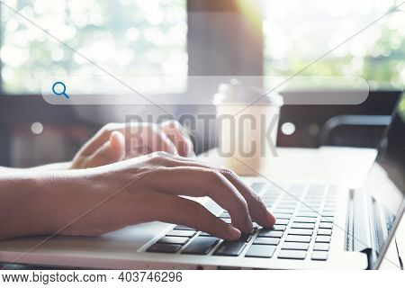 Searching Information Data On Internet Networking Concept. Women Use Laptop To Search The Internet,