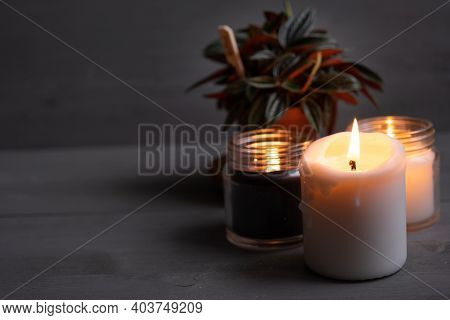 Candles. Home Interior Decoration. Romantic Candles. White And Black Wax. In Glass Jars. Romantic At