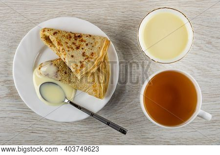 Teaspoon, Thin Russian Pancakes Poured Condensed Milk In White Plate, Bowl With Condensed Milk, Cup