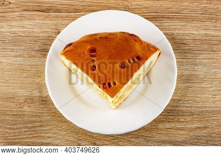 Piece Of Pie With Cabbage And Egg In White Plate On Wooden Table. Top View