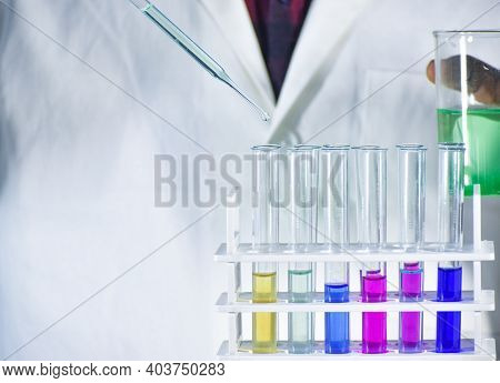 Test Tube With Color Solution. Test Tube In Test Tube Stand. Scientist Taking Color Solution In A Te