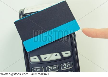 Hand Of Woman Showing Credit Card Reader With Contactless Credit Card. For Cashless Paying For Diffe
