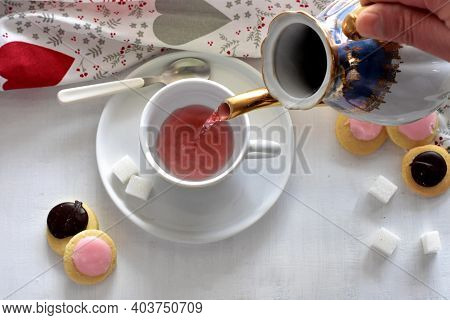 Tea Ceremony Pouring Hot Tea Into The Cup Whit Tea Biscuits And Cookies At White Wooden Background B