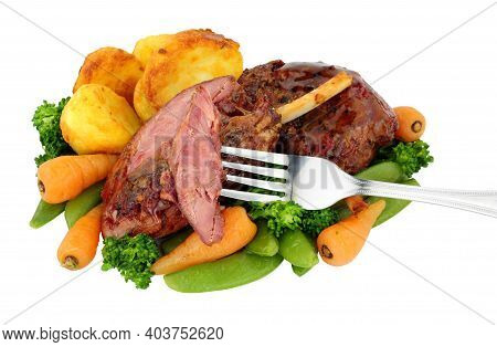 Slow Cooked Cured Gammon Shanks Covered With Caramelised Maple Sauce And Roast Potatoes, Carrots, Br