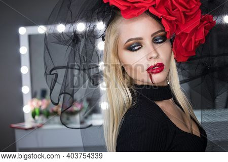 Attractive Lady With Spill Of Blood Near Lips Smirking And Looking At Camera While Wearing Gothic Ou