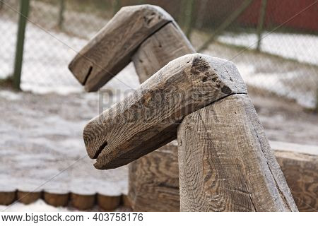 Two Wooden Horses In The Schoolyard At Roback