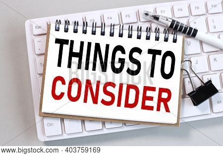 Things To Consider. Text On White Paper On White Keyboard On Gray Background