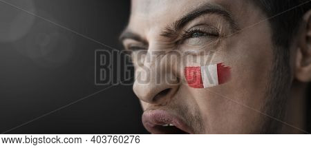 A Screaming Man With The Image Of The Peru National Flag On His Face