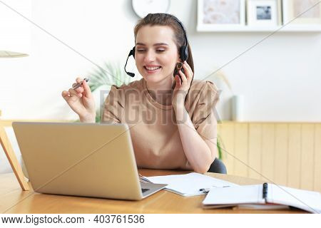 Freelance Operator Talking With Headsets And Consulting Clients From Home Office.