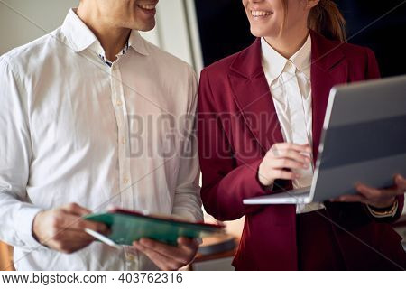 Young couple on a beautiful morning in the hotel room preparing for a meeting at their business trip for a new deal. Hotel, business, people