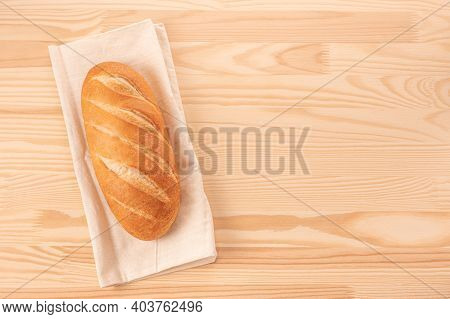 Loaf Of Bread On Wooden Table Background. Whole Bread. Template Homemade Bread Recipe. Cost Of Bread