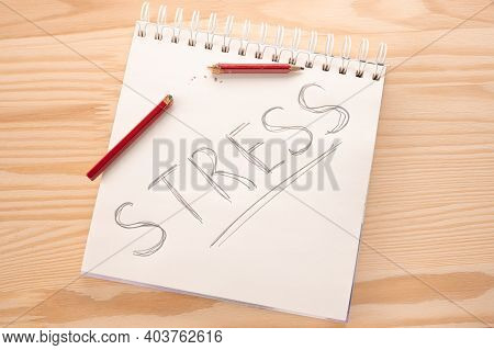 Stress Concept. Stress Relief And Management Concept. Notepad With Word Stress And Broken Pencil In