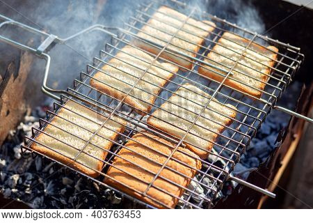 Toast Is Fried Over Charcoal. Bbq Grill. Cooking Crispy, Tasty Croutons Over The Fire