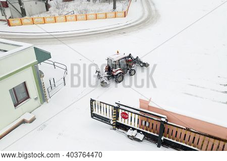 Utility Tractor Pulled Out To Clear Snow From Roads Top View.