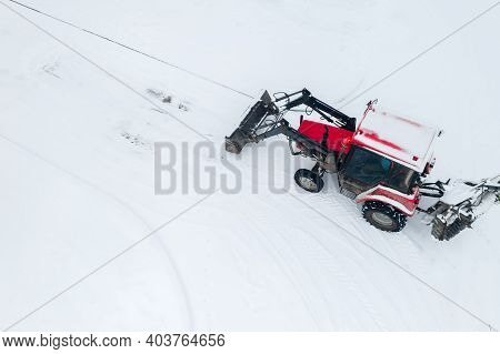 Tractor Clears The Road From Snow Top View From The Throne.