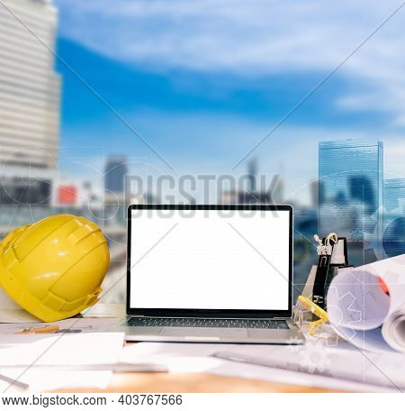 Engineer And Architecture Technology Concept With Building Background And Empty Laptop Screen For Te