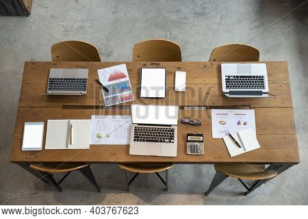 Business Computer Office Desk With Desktop Laptop, Tablet, Calculator, Notebook, And Annual, Summary