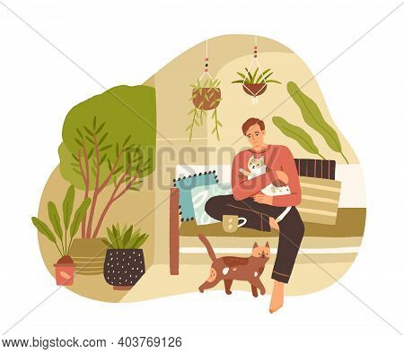 Young Man Spending Leisure Time With Cats At Home, Drinking Tea, Relaxing And Enjoying Slow Life. Ca