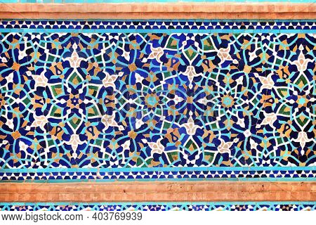 Detail of traditional persian mosaic wall with floral ornament,  Grand Jame Mosque (Masjid-e Jameh Mosque, Friday Mosque) in Yazd, Iran