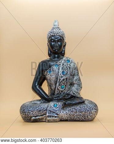 Small Buddha Image Isolated On Light Background