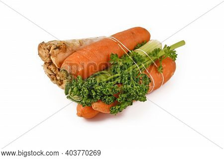 Bundle Of Soup Vegetables Containing Carrots, Leeks, Parsley And Celery Root Isolated On White Backg