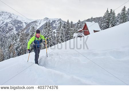 Young Man In Action On Climbing Touring Skis