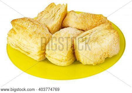 Few Puff Cookies In Yellow Glass Plate Isolated On White Background