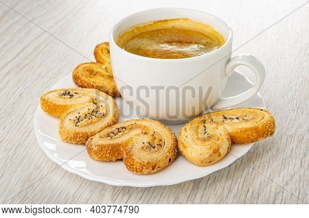 Puff Cookies With Poppy Seeds, Black Coffee In White Cup On Plate On Wooden Table