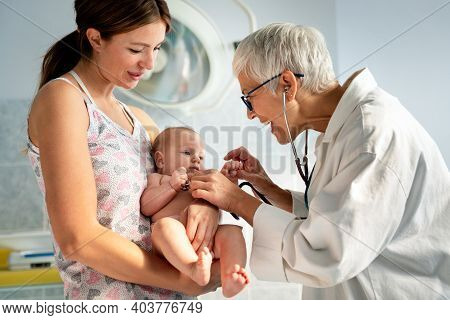 Pediatrician Doctor Examines Baby. Healthcare, People, Examination Concept