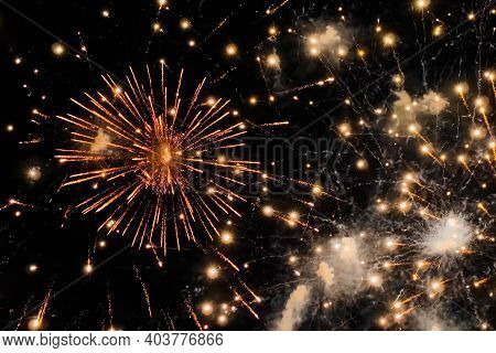 Holiday, Celebration And Anniversary Concept. Colorful Bright Fireworks In Dark Sky At Night. Evenin