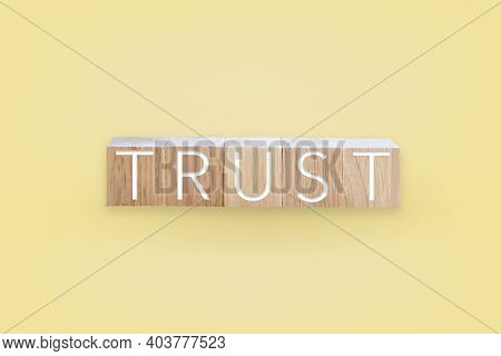 Trust Word On Wooden Board With Color Background.