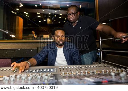 Nigerian Music Producer Cobhams Asuquo Working In Studio