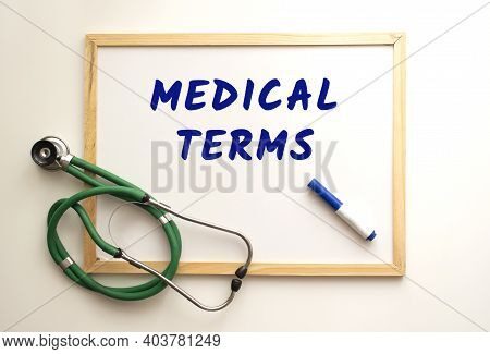 The Text Medical Terms Is Written On A White Office Board With A Marker. Nearby Is A Stethoscope. Me