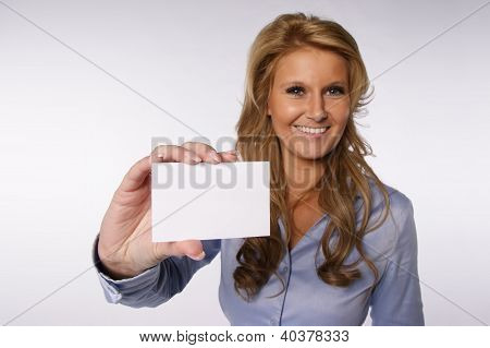 Woman showing her business card