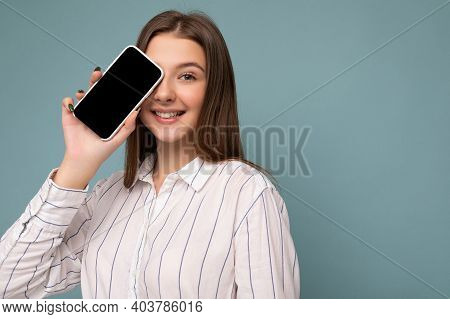 Closeup Photo Of Positive Attractive Young Blonde Woman Wearing Casual White Shirt Isolated Over Blu