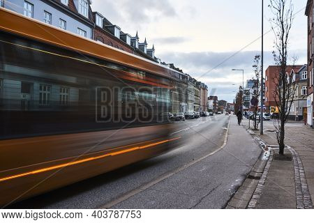 Moving Bus On Street Road In City In Denmark