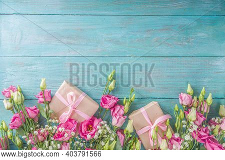 Beautiful Spring Flowers On Light Blue Wooden Background. Festive Floral Composition With Craft Pape