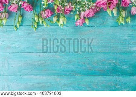 Festive Floral Invitation, Greeting Card Background With Summer Spring Flowers On Light Blue Wooden