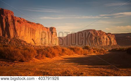 Reddish Desert Of Arizona Sunset Scenery. Sandstones Of The Monuments Valley. Scenic Red-sand Desert