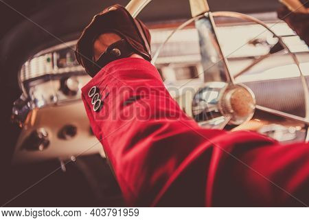 Classic Car Collector Driving His Vintage Car. Hands On The Vehicle Steering Wheel Close Up. Automot